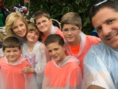 This is me and my family right before we went on a water ride. That's why we're wearing those weird bag things called ponchos.