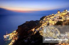 View of the Aegean Sea from the typical Greek village of Oia at dusk, Santorini…