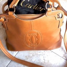 Authentic Cartier Bag As seen on Serena van der Woodsen! Beautiful hardly worn classic leather logo Cartier bag. Very spacious, beautifully made. Lower price is negotiable through PayPal. Comes with dust bag. Cartier Bags