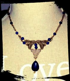 Blue triskell necklace with lapis