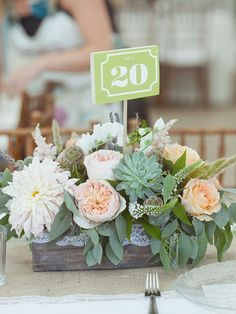 Succulent centerpieces are so in! Include these adorable DIY botanical arrangements into wooden planters for a rustic wedding reception.
