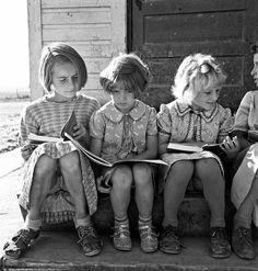 Girls of Lincoln Bench School study their reading lesson. Near Ontario, Malheur County, Oregon, 1939