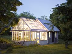 Greenhouse and shed combo - looks great with the lighting. Greenhouse and shed combo - looks great w Greenhouse Plans, Greenhouse Gardening, Greenhouse Shed Combo, Greenhouse Attached To House, Greenhouse Wedding, Garden Landscape Design, Garden Landscaping, Gazebos, Wooden Greenhouses