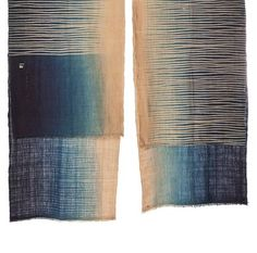 indigo dyed cotton. I loved doing indigo dye in my textiles class when I was an art major. Beautiful.