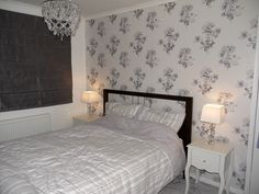 Grey, white and silver main bedroom renovation.