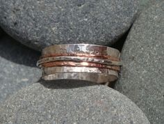 This beautiful sterling silver and copper ring has been hand beaten to give it a rustic look The Ring is wide & Size T Great for a mans ring or thumb ring Can be made to order any size Thumb Rings, Copper Rings, Band Rings, Wander, Rings For Men, Wedding Rings, Amp, Engagement Rings, Sterling Silver