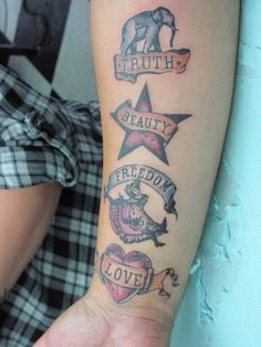 Moulin Rouge tattoo but in the right order (freedom, beauty, truth, and love)