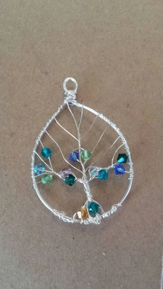 Items similar to Custom order Family Tree. Makes a wonderful gift to any mother or grandmother! on Etsy Wire Jewelry, Handmade Jewelry, Birthstones, Swarovski Crystals, Etsy Seller, Wire Trees, Pendants, Beads, How To Make