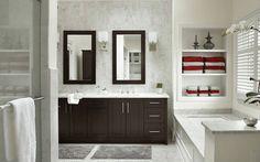 Dark Vanity And White Stone - Dark wood with white materials creates a classic look