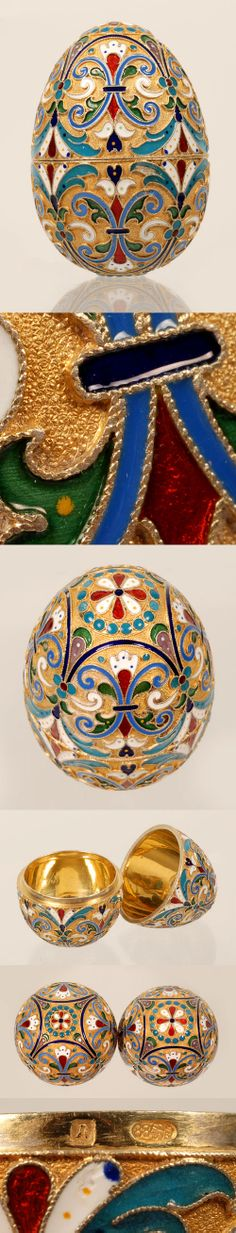 A Russian gilded silver and cloisonne enamel egg, Lubavin, St. Petersburg, Circa 1899-1908. The two-part egg is worked in a vibrant multi-color scroll motif against a gilded stippled ground.