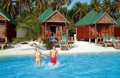 Couple on the beach #voyagewave #maldivesholidays → www.voyagewave.com