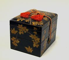 Japanese box and utensils for incense ceremony set ~  Black lacquer decorated with sprinkled lacquer; clematis and butterfly folded incense paper design ~  Edo period (1615-1868)