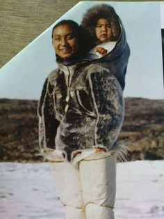 Thule/Qaanaaq. unuit mother, carrying her child in an amaut