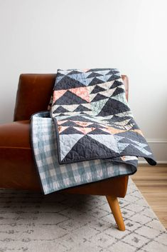 Geese in Flight twin size quilt in Driftless fabric collection by Anna Graham for Robert Kaufman Fabrics. Quilting by Kaitlyn of Knot + Thread. Quilt Patterns, Sewing Patterns, Twin Quilt Size, Quilted Throw Blanket, Crochet Quilt, Contemporary Quilts, Flying Geese, Scrappy Quilts, Simple Shapes