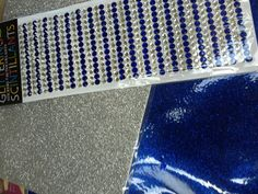 Silver and blue glitter paper and gems