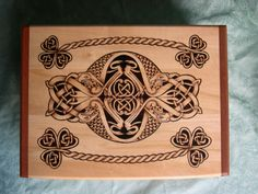 Ivan Govaerts is a talented man who creates beautiful Celtic wood pieces. This is a wooden box, custom made for someone Ireland, with lovely knotwork and Irish patterns. I've shared pics of his work several times, but check out his FB page for more images :http://www.facebook.com/ivan.govaerts.9