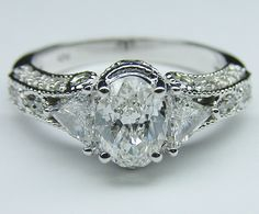 We looked at this one together... Vintage Style Oval Diamond Engagement Ring 0.83 tcw. In White Gold
