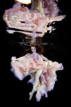 Ilse Moore photographed these models below the surface of water to have Joel Janse Van Vurren's dresses flow freely with the water.