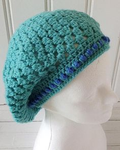 The beauty of berets, is that you can make them any size you wish. Old fashioned berets sat high on top of the head, and had a fixed shape. These slouchy berets