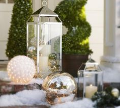 Have extra ornaments? Don't leave them in the attic! Display them in lanterns or other glass vessels. It will add instant holiday sparkle inside or out. PB