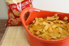 This Frito Pie dish comes together in minutes and will be done baking within half an hour. It's the perfect appetizer and game day grub.