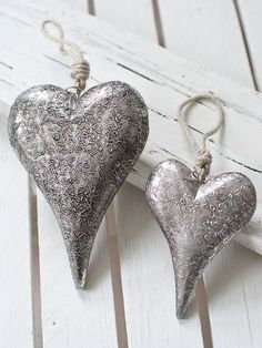 Fabulous large vintage wooden heart with a silvered metal outer, decorated with a distressed, raised floral pattern. <br/>Finished with a lovely contrasting natural rope loop, ready for hanging.