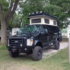 Sportsmobile with Aluminess bumpers, roof rack and ladder