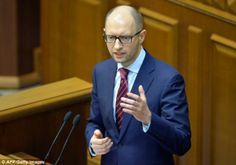 Ukraine's newly appointed Prime Minister Arseniy Yatsenyuk delivers a speech at the Ukrainan parliament on Thursday