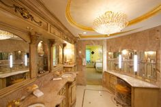 Unique handmade tiles on the floor and walls in both bath and walk in closet, and hand painted and finished vanity cabinets all contribute to the projects one of a kind style. With all its old world feel, the bath still contains the height of modern conveniences, utilizing computerized multiple shower heads.