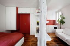 Surprisingly Small Apartment in Paris with a Charming Red Interior