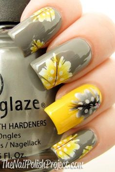 Nails decorated with yellow and gray flowers