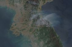 On April 25, 2014, dozens of fires burned in North Korea, sending smoke over the Sea of Japan.