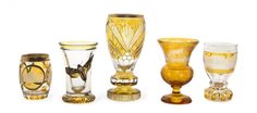 A Collection of Five Bohemian Amber Glass Articles