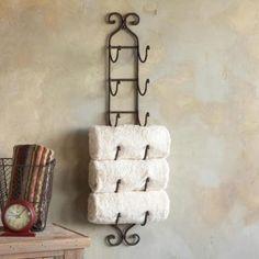 Wine rack doubles as towel holder.