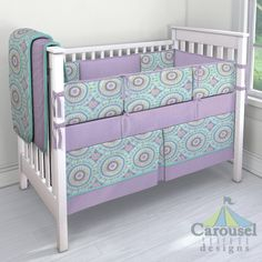 Crib bedding in Purple Dots, Aqua Haute Circles, Solid Teal. Created using the Nursery Designer® by Carousel Designs where you mix and match from hundreds of fabrics to create your own unique baby bedding. #carouseldesigns