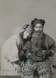 Ainu husband and wife.  Hokkaido, northern Japan.  About 1900.  Hand-colored.  MIA