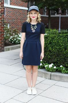 Poor Little It Girl in Black and Navy Madewell Dress, J.Crew Wool Baseball Cap, Just Jems Beading Company Green Necklace, Canvas BucketFeet Sneakers