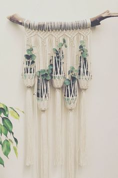 Short on space? We found a decorative wall hanging and planter combo that would suit your wall.
