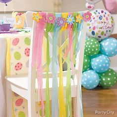 Love this: Add a pretty touch to seating with paper streamers and spring flowers.