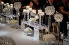 Pure glam — pair mirrored cubes with crystals and white flowers.