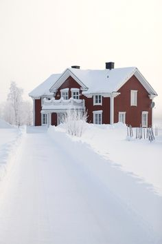 Red old farmhouse with white windows. Winter Wonderland, Norbotten, Sweden.