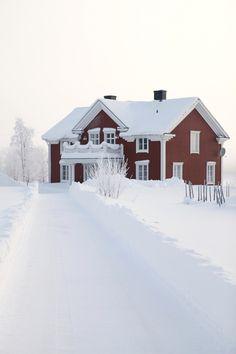 Red old farmhouse with white windows. Winter Wonderland, Norbotten, Sweden.