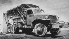 GMC CCKW 2 1/2 Ton 6x6 Cargo Truck (G-508) closed cab with winch being fueled by Elizabeth Jarrard,71st Post HQ Co, Hampton Roads Port of Embarkation, 7 June 1943
