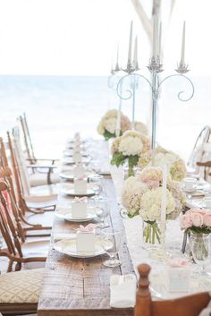 This baby shower table is so gorgeous and luxe. Is that the ocean we spy in the background?