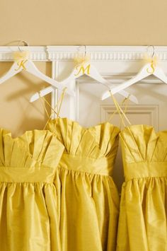 assuming these are bridesmaid dresses. love the monogrammed hangers!