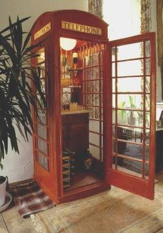 A GENUINE BRITISH RED PHONE BOX CONVERTED INTO A DRINKS CABINET/BAR.MADE TO ORDER.FULLY EQUIPPED WITH OPTICS WINE COOLE HARDWOOD BAR GENUINE OPENING /CLOSING HOURS BRITISH TIME/FULL PRICE LIST IN £s THE BRITISH BEER WINE MENU. FITTED OUT WITH LIGHTING