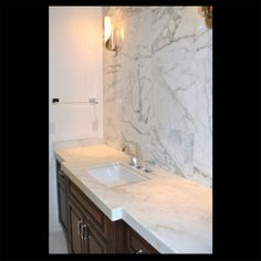 Calacatta Extra - Project by Arkitron Corp and RAF Projects Custom Crates, Calacatta Gold Marble, Engineered Stone, Gold Bathroom, Building A House, Build House, Gold Highlights, Stone Tiles, Beautiful Bathrooms