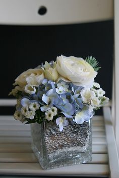 silk floral arrangement, hydrangea, white roses and wax flower