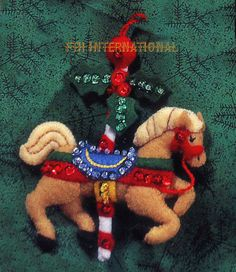 Bucilla  ~ Carousel Horses ~ 8 piece Felt Christmas Ornament Kit #83408.  This is a discontinued 1996 pattern so if you love it please make sure you dont miss the chance to purchase this rare and hard to find kit.  These Carousel Horse ornaments are sure to bring back happy memories for anyone who has ever had the pleasure of riding the carousel at a carnival, amusement park, or..... You will almost be able to hear the distinctive music of the carousel as you hang these adorable ornaments on…