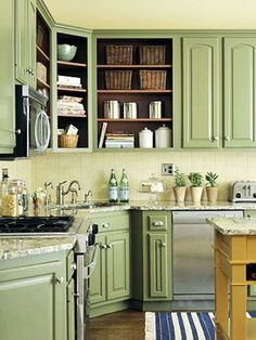 I kinda want green kitchen cabinets. Less Is More ~ Removing the doors from some of the upper cabinets reveals the space inside, making the kitchen look larger. Paint the interior a rich accent color to spice up the kitchen even more. Green Kitchen Cabinets, Kitchen Cabinet Colors, Painting Kitchen Cabinets, Kitchen Paint, Kitchen Redo, New Kitchen, Kitchen Dining, Sage Kitchen, Kitchen Colors